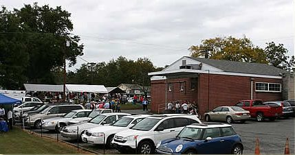 Tents and crowd gathering in front of Fellowship Hall.