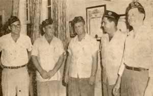 Five American Legionaires. wearing organization's caps.