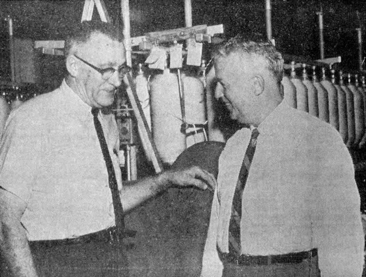 Paul talks with Jim Scruggs inside mill.