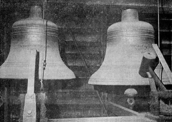 "PERSONALITY FACTOR—Pictured here are two of the smaller bells—the left one is about the size of a normal church bell. With four bells in the belfry, the largest one (which is positioned to the right of these two) is about the size of a giant cathedral bell. Instead of the ""clapper"" style of ringing, the bells are struck by large hammers on the outside, resembling a sledgehammer. The bells are the single factor that account for the clock's personality"