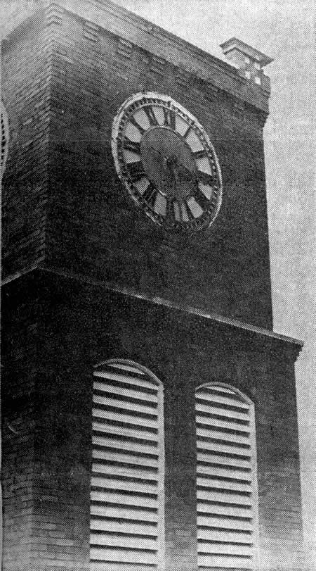 CLOCK TOWER—Now in its 50th year, the majestic clock in Cliffside has chimed its message to mankind on the streets below. Even though the face of the clock appears relatively small, inside the clock tower, an average man could stand upright with room to spare on the inside of the face alone. The dials are lighted at night by a circular construction of conduit, with regular household lights positioned strategically around.