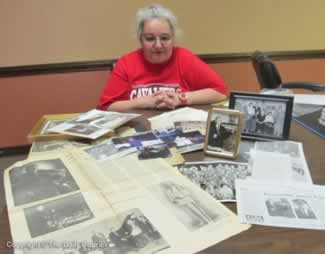 Jane displaying her family and personal memorabilia