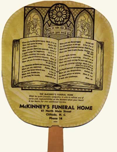 Fan distributed by McKinney's Funeral Home, 61 North Main Street, Cliffside, N. C. Phone 14. Text below drawing of an open Bible listing familiar verses.
