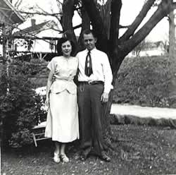 The McMurrays standing beneath a large tree.