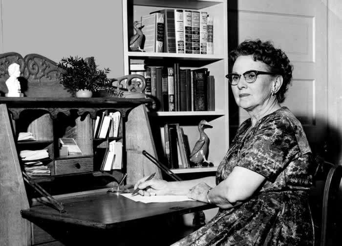 To illustrate the story of Ina the writer, she sits at her writing desk.