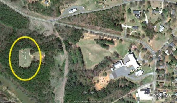 A satellite view of upper Cliffside showing the cemetery about half a mile away from the school, in a clearing in a large wooded area.