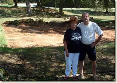 Janice and Marc Swing standing on the cleared lot where their new home will be built.