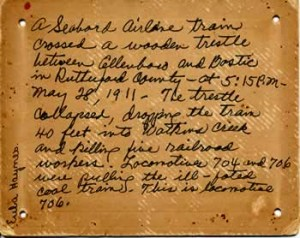 The back of the hundred-year-old postcard, brown with age, has the description of the even, handwritten by Eula Haynes.