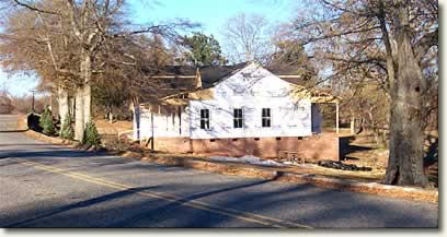 View of house construction from across the street.