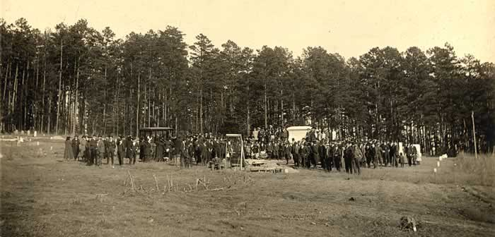 The Cemetery with funeral party in distance