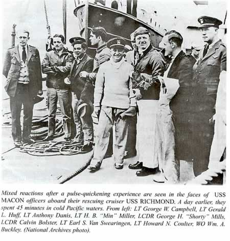 """Photo with this caption: Mixed reactions after a pulsw-quickening experience are seen in the faces of USS Macon officers aboard their rescuing cruiser USS Richmond. A day earlier, they spent 45 minutes in cold Pacific waters. From left: LT George W. Campbell, LT Gerald L. Huff, LT Anthony Danis, LT H. B. """"Min"""" Miller, LCDR George """"Shorty"""" Mills, LCDR Calvin Bolster, LT Earl S. Van Swearingen, LT Howard N. Coulter, WO Wm. A Buckley. National Archives photo."""