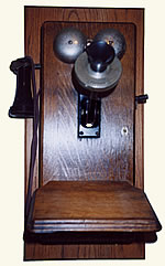 Old wooden wall phone  with side crank.