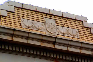 Crest on front of Romina Building