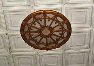 An ornate circular light fixture near the ceiling.