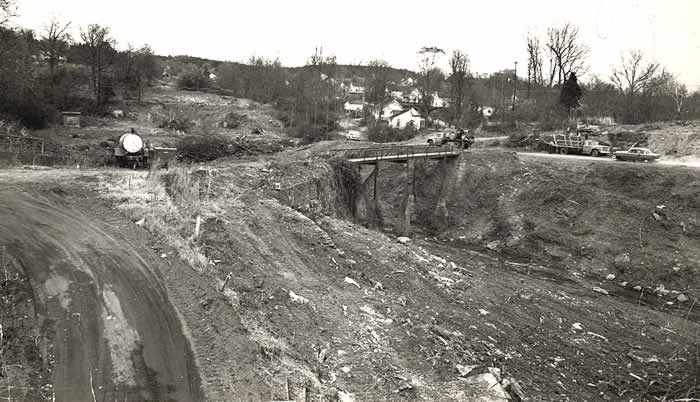 Looking northeast from the river bridge. The landscape has been devastated by bulldozers and earth movers. There are few remaining identifiable landmarks. Houses on Church and Academy Streets can be seen in the distance.