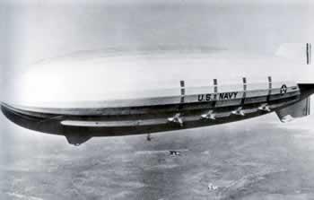 The Macon dirigible in flight.