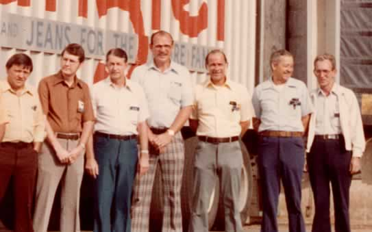 Closeup of the right 7 men in the line.