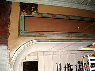 The curved proscenium arch where the screen was once positioned