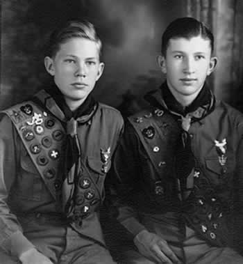 Two scouts sitting for a studio portrait