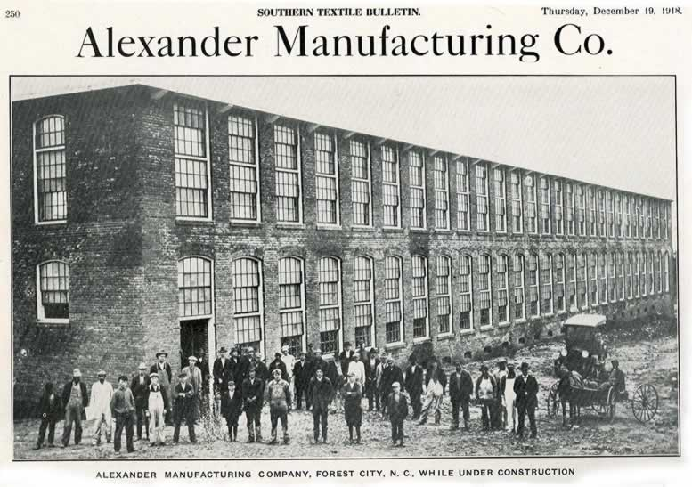 "A clipping headlined ""Alexander Manufacturing Co."" with a wide shot of the two-story mill. In the foreground are about 40 workmen, one Model-T Ford and a horse-drawn buckboard. The caption identifies the mill as in Forest City, N. C. and as being under construction."