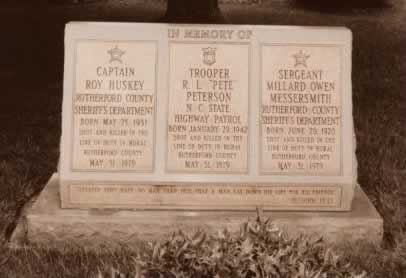 A wide granite slab on which is carved three tributes, one for each of the murdered officers.