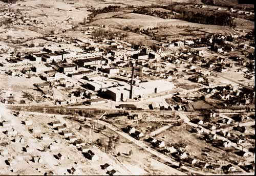 Aerial view of mill among streets of mill houses.