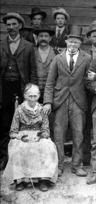 Mary Anne is seated, Amos is standing beside her.