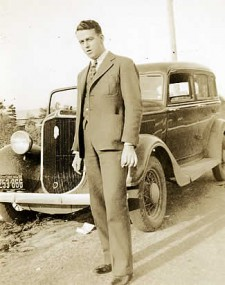 Paul, standing beside his Ford sedan