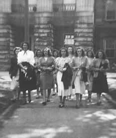 A group of senior class girls walking about on the capital grounds.