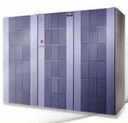 A large floor-standing cabinet with three doors, inside of each are many rack-mounted electronic components.
