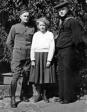 Elifus, in WWI Doughboy uniform, and Bum Goode is Navy uniform, stand with Mary.