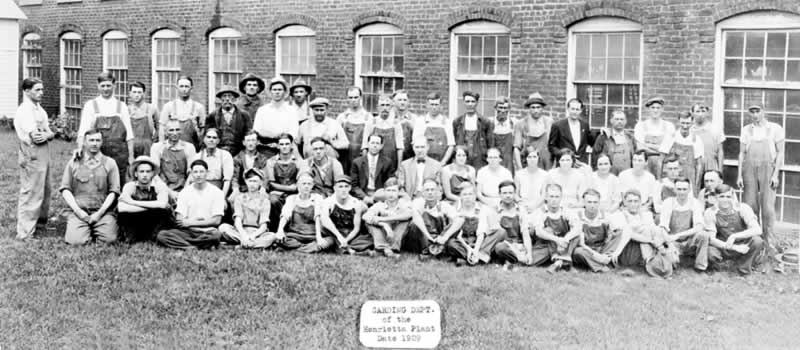 30 or 40 Card room workers outside mill for official photo.