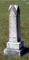 An obelisk-shaped gravestone