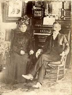 Uncle Dobb and wife in early 1900s parlor.