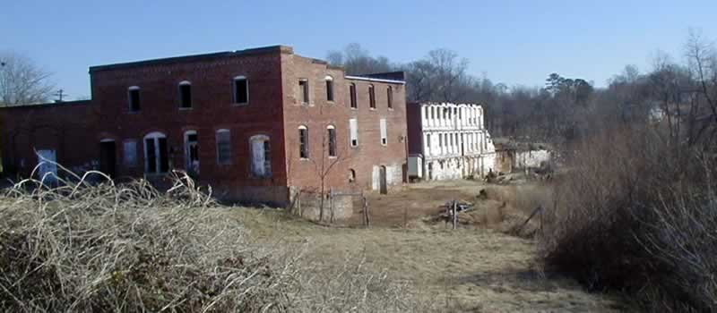 Mill buildings in dilapidated state. Just before being razed.