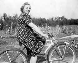 Lovely old lady poses on bicycle