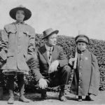 Two kids in WWI uniforms with their daddy