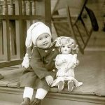 Little girl on steps with her doll