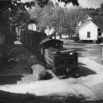 train moving through neighborhood