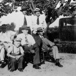 Men relaxing in yard