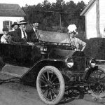 Family in open Model T Ford