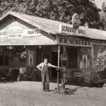 Owner standing in front of country store