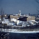 A wintry panorama of the mill and town