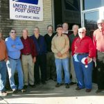 10 Cliffside men standing in front of post office