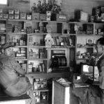 Two service station attendants inside store