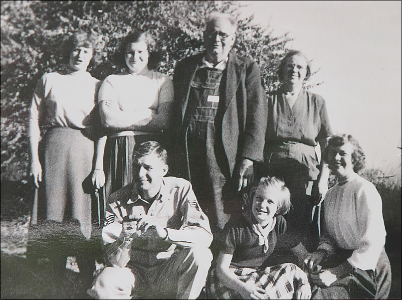 The parents and their four daughters and one son.