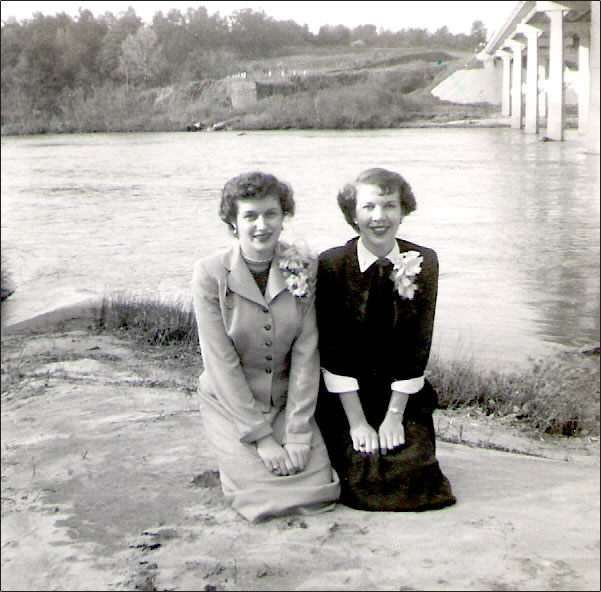 They dressed for some occasion, wearing corsages, and kneeling on the river's edge, with their backs to the stream.