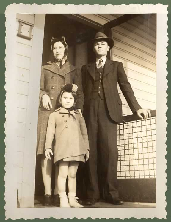 1940s family at doorway.