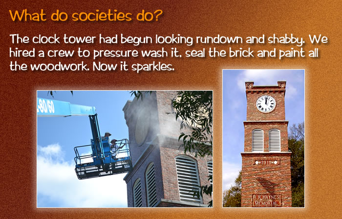 The clock tower had begun looking rundown and shabby. We hired a crew to pressure wash it, seal the brick and paint all the woodwork. Now it sparkles. [Photos: Men on a power lift pressure washing the brick on one side of the tower. And a beautiful shot of the sparkling tower and clock.]
