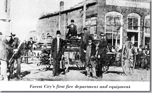 Forest City's first fire department and equipment (a primitive ladder truck).